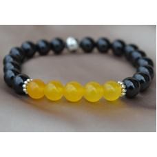 Črni oniks in rumeni žad raztegljiva zapestnica.
